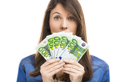 Woman holding some Euro currency notes. Beauitful woman holding some Euro currency notes, isolated over white background Royalty Free Stock Photo