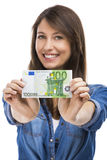 Woman holding some Euro currency notes. Beauitful woman holding some Euro currency notes,  over white background Stock Photo