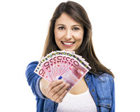 Woman holding some Euro currency notes. Beauitful woman holding some Euro currency notes,  over white background Stock Photos
