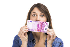 Woman holding some Euro currency notes. Beauitful woman holding some Euro currency notes,  over white background Royalty Free Stock Images
