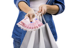 Woman holding some Euro currency notes. Beauitful woman holding shopping bags and some Euro currency notes,  over white background Stock Photo
