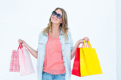 Woman holding some shopping bags Royalty Free Stock Photos