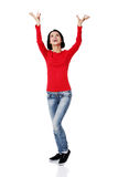 Woman  is holding something above her head. Royalty Free Stock Image
