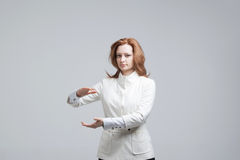 Woman holding something in hands Royalty Free Stock Photography