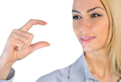 Free Woman Holding Something In Fingers Royalty Free Stock Images - 49409569