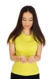 Woman holding something on palms. Stock Photo