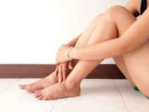 Woman holding sore leg. Close up Stock Image