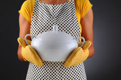 Woman Holding Soup Tureen Stock Images