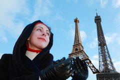 Woman holding souvenir, view of Eiffel Tower Stock Photo