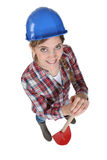 Woman holding spade. Female manual worker holding spade Royalty Free Stock Image