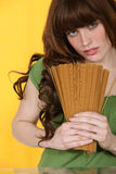Woman holding spaghetti Royalty Free Stock Images