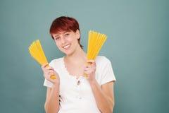 Woman holding spaghetti Stock Photos