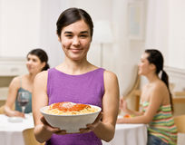 Woman holding spaghetti about to serve friends Royalty Free Stock Photography