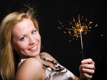 Woman holding sparkler and celebrating Royalty Free Stock Photos