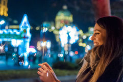 Woman holding sparkler in her hand, celebrating New Year`s Eve stock images