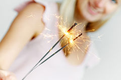 Woman Holding Sparklers In Her Hand Royalty Free Stock Photos