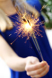 Woman holding sparklers Royalty Free Stock Images