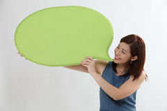 Woman holding speech bubble Stock Images