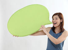 Woman holding speech bubble Royalty Free Stock Photography