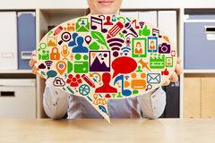 Woman holding speech bubble with social media icons Royalty Free Stock Images