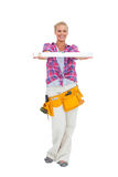Woman holding a spirit level smiling at camera Royalty Free Stock Images