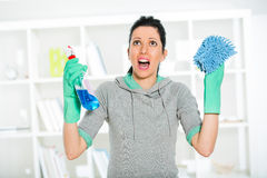 Woman holding a sponge and sprayer for cleaning Stock Image