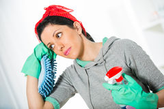 Woman holding a sponge and sprayer for cleaning Stock Photos
