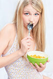 Woman holding spoon and corn flakes Stock Photos