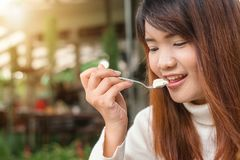 Woman Holding Spoon Trying to Eat White Food Stock Image