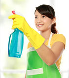 Woman holding sprayer cleaning tool Royalty Free Stock Photo