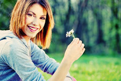 Woman holding spring flower Stock Images