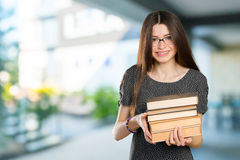 woman holding stack of books Royalty Free Stock Photo