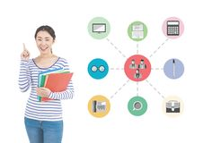 Woman holding stack of books with various applications Stock Image