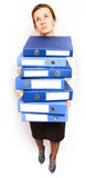 Woman holding stack of folders. Woman holding a stack of folders Royalty Free Stock Images