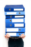 Woman holding stack of folders Stock Photography