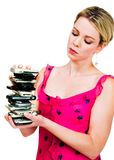 Woman holding a stack of mobile phones. Isolated over white Royalty Free Stock Photo