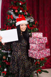Woman holding stack of presents Stock Image