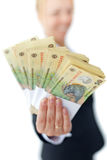 Woman holding stacks of romanian currency Royalty Free Stock Images
