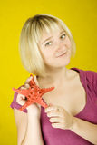Woman holding starfish Stock Images