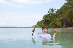 Woman holding the starfish and diving mask Stock Images