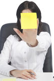 Woman holding sticker note in front of the face Stock Photo