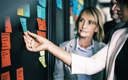 Woman Holding Sticky Note Royalty Free Stock Image