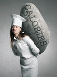 Woman holding a stone with calories concept. A Unhealthy food concept Stock Images