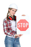 Woman holding stop sign Stock Images