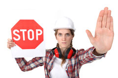 Woman holding stop sign royalty free stock image
