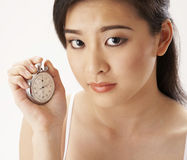 Woman holding stop watch Stock Photo