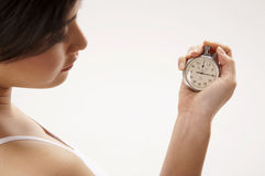 Woman holding stop watch stock images