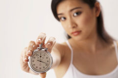 Woman holding stop watch Royalty Free Stock Photos