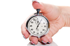 Woman holding a stopwatch Royalty Free Stock Photos