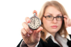 Woman holding a stopwatch Royalty Free Stock Image